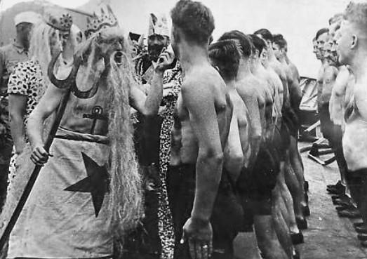 "German sailors in the 1930s being addressed by King Neptune while ""crossing the line."""